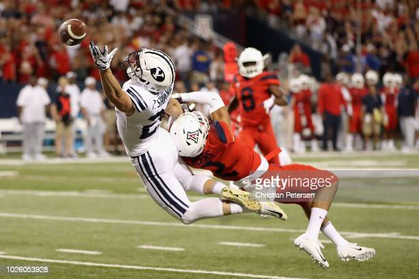 Wide receiver Talon Shumway of the Brigham Young Cougars is unable to catch a pass defended by cornerback Lorenzo Burns of the Arizona Wildcats...