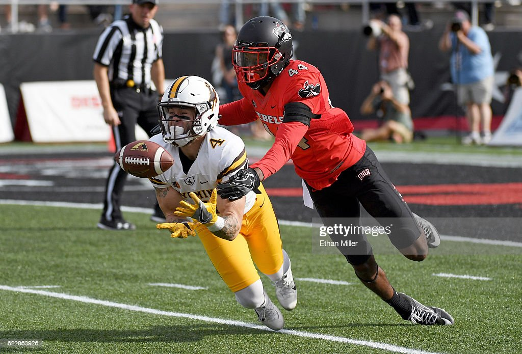 Wide receiver Tanner Gentry #4 of the Wyoming Cowboys catches a 50-yard pass against defensive back Kenny Keys #44 of the UNLV Rebels during their game at Sam Boyd Stadium on November 12, 2016 in Las Vegas, Nevada.