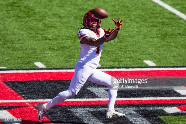 Wide receiver Tarique Milton of the Iowa State Cyclones catches a pass during the second half of the college football game against the Texas Tech Red...