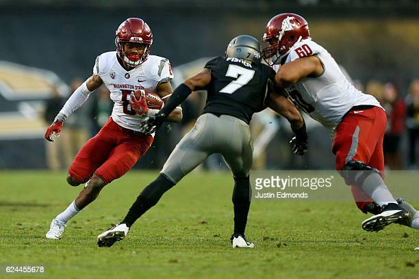 Wide receiver Tavares Martin Jr #8 of the Washington State Cougars runs with the ball after making a catch for a first down during the fourth quarter...