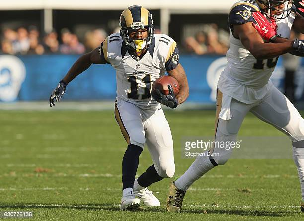 Wide receiver Tavon Austin of the Los Angeles Rams carries the ball in the second quarter against the Arizona Cardinals at Los Angeles Memorial...