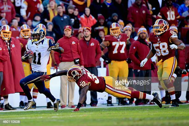 Wide receiver Tavon Austin of the St Louis Rams avoids the tackle by running back Silas Redd of the Washington Redskins as he scores a third quarter...