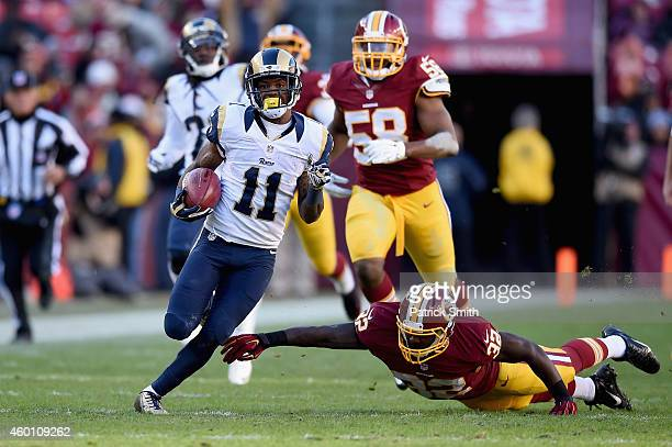 Wide receiver Tavon Austin of the St Louis Rams avoids the tackle of running back Silas Redd of the Washington Redskins as he scores a third quarter...