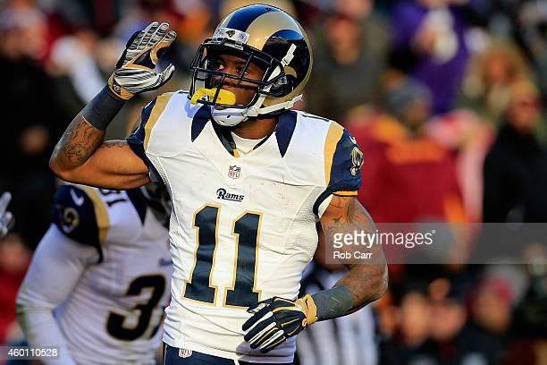 Wide receiver Tavon Austin of the St Louis Rams celebrates after a third quarter punt return touchdown against the Washington Redskins at FedExField...