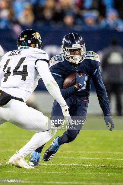 Wide receiver Taywan Taylor of the Tennessee Titans carries the ball against the Jacksonville Jaguars at Nissan Stadium on December 6 2018 in...