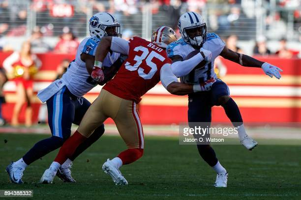 Wide receiver Taywan Taylor of the Tennessee Titans is tackled by strong safety Eric Reid of the San Francisco 49ers during the first quarter at...