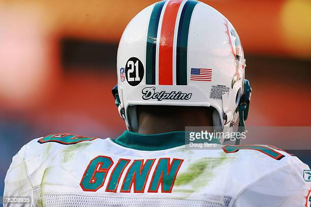 Wide receiver Ted Ginn Jr #19 of the Miami Dolphins stands on the sideline with a on his helmet in memory of slain Washington Redskins player Sean...