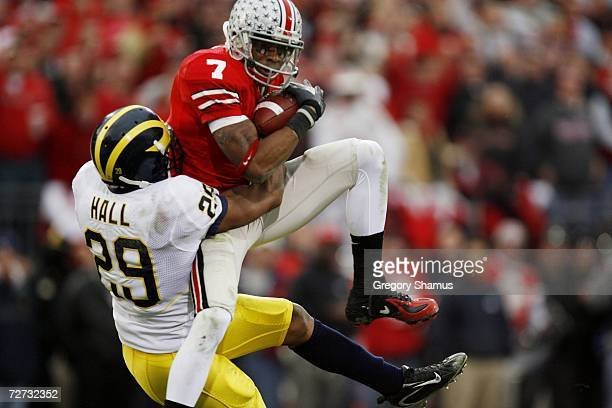 Wide receiver Ted Ginn Jr #7 of the Ohio State Buckeyes makes a catch against cornerback Leon Hall of the Michigan Wolverines on November 18 2006 at...