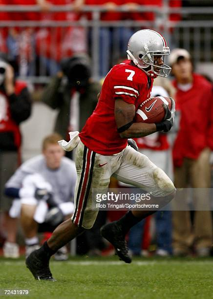 Wide Receiver Ted Ginn Jr. #7 of the Ohio State Buckeyes runs with the ball against the Penn State Nittany Lions at Ohio Stadium on September 23,...