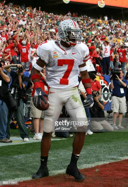 Wide receiver Ted Ginn Jr #7 of the Ohio State Buckeyes stands in the back of the endzone after he catches a 56yard touchdown pass in the first...