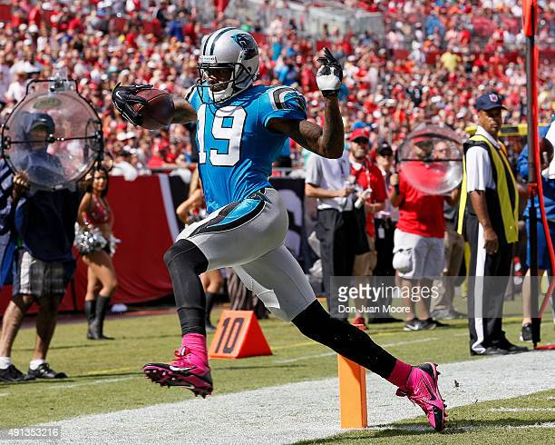 Wide Receiver Ted Ginn Jr of the Carolina Panthers scores on a touchdown during the game against the Tampa Bay Buccaneers at Raymond James Stadium on...