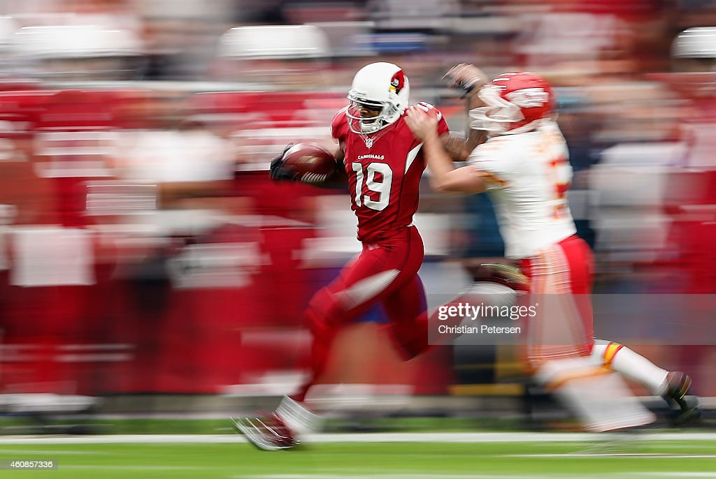Wide receiver Ted Ginn #19 of the Arizona Cardinals runs back a kickoff during the first half of the NFL game against the Kansas City Chiefs at the University of Phoenix Stadium on December 7, 2014 in Glendale, Arizona.