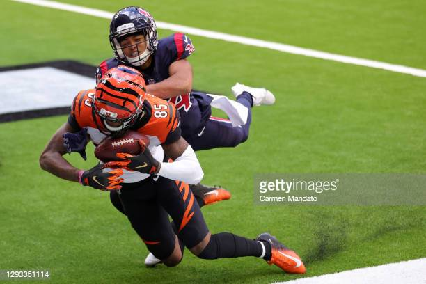 Wide receiver Tee Higgins of the Cincinnati Bengals completes a pass for a touchdown over cornerback John Reid of the Houston Texans during the third...
