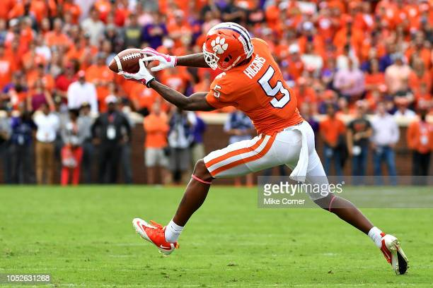 Wide receiver Tee Higgins of the Clemson Tigers makes a reception in the open field against the North Carolina State Wolfpack during the football...