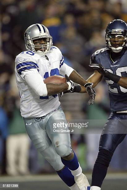 Wide receiver Terrance Copper of the Dallas Cowboys runs into the endzone for a touchdown against the Seattle Seahawks on December 6, 2004 at Qwest...