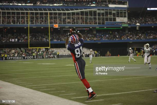 Wide Receiver Terrell Owens of the Buffalo Bills has a sideline catch when the New York Jets face the Buffalo Bills at Rogers Centre on December 3...