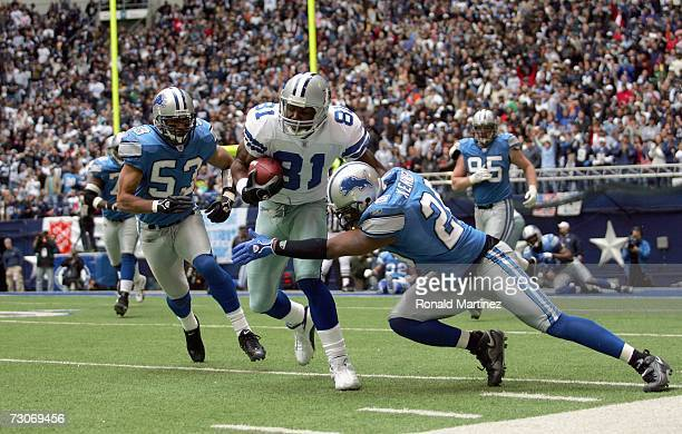 Wide receiver Terrell Owens of the Dallas Cowboys is tackled by Kenoy Kennedy of the Detroit Lions at Texas Stadium on December 31 2006 in Dallas...