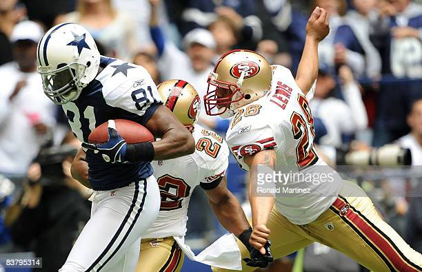 Wide receiver Terrell Owens of the Dallas Cowboys makes a touchdown pass reception against Nate Clements and Keith Lewis of the San Francisco 49ers...