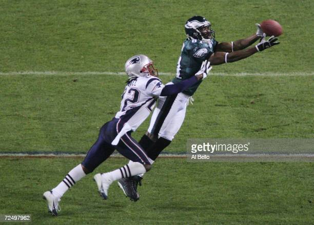 Wide receiver Terrell Owens of the Philadelphia Eagles catches a 10yard pass against Asante Samuel of the New England Patriots during the fourth...