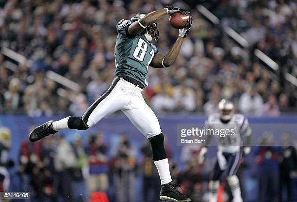 Wide receiver Terrell Owens of the Philadelphia Eagles makes the reception for a 30-yard completion during the first quarter of Super Bowl XXXIX...