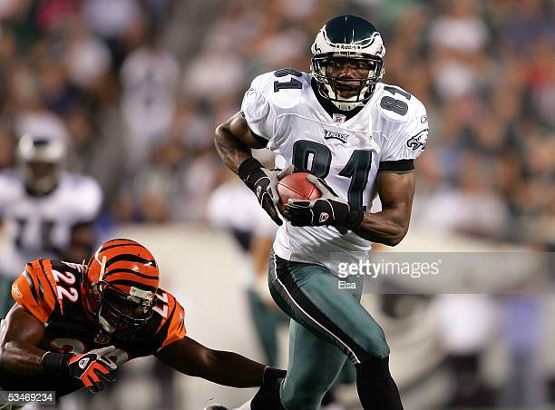 Wide receiver Terrell Owens of the Philadelphia Eagles runs past safety Kim Herring of the Cincinnati Bengals during the first half of their...