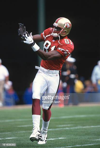Wide Receiver Terrell Owens of the San Francisco 49ers catching a pass in pregame warmup before an NFL football game against the New Orleans Saints...