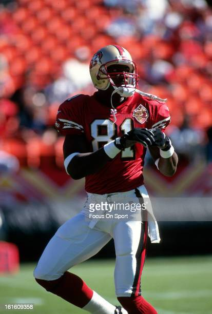 Wide Receiver Terrell Owens of the San Francisco 49ers catching a pass in pregame warmup before an NFL football game circa 1996 at Candlestick Park...