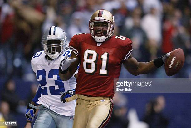 Wide receiver Terrell Owens of the San Francisco 49ers celebrates in the end zone after catching the game winning touchdown against the Dallas...