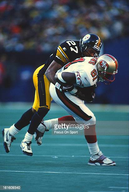 Wide Receiver Terrell Owens of the San Francisco 49ers gets tackled by Willie Williams of the Pittsburgh Steelers during an NFL football game...