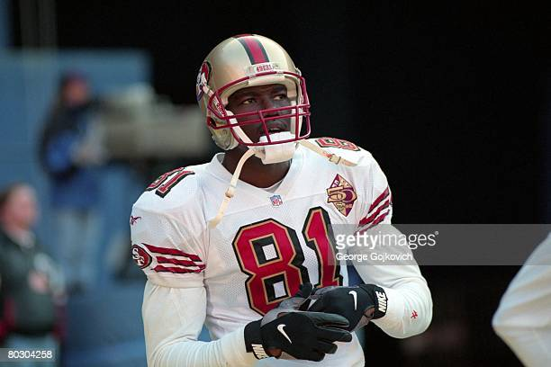Wide receiver Terrell Owens of the San Francisco 49ers looks on from the field before a game against the Pittsburgh Steelers at Three Rivers Stadium...