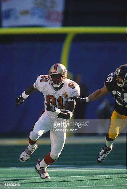 Wide Receiver Terrell Owens of the San Francisco 49ers runs a pass rout defended by Rod Woodson of the Pittsburgh Steelers during an NFL football...