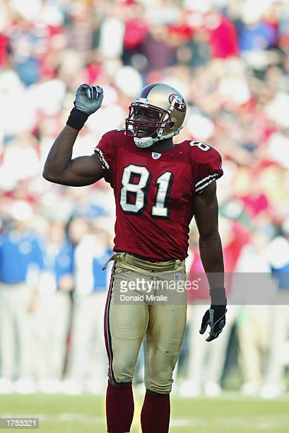 Wide receiver Terrell Owens of the San Francisco 49ers salutes the crowd after his first quarter touchdown during the NFC Wild Card game against the...