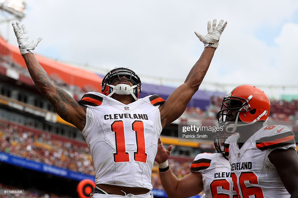 Wide receiver Terrelle Pryor #11 of the Cleveland Browns celebrates with teammate tight end Randall Telfer #86 after scoring a second quarter touchdown against the Washington Redskins at FedExField on October 2, 2016 in Landover, Maryland.