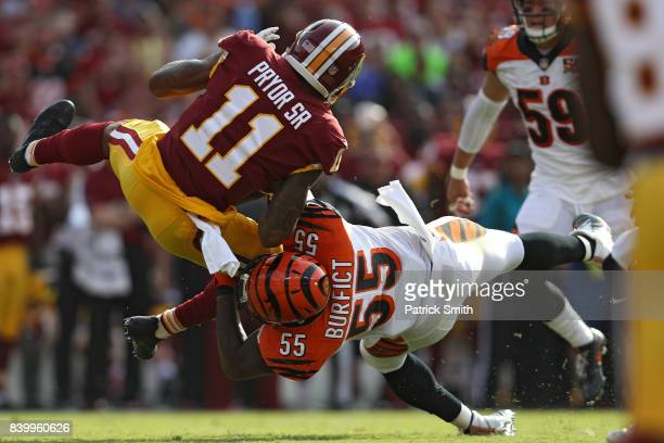 Wide receiver Terrelle Pryor of the Washington Redskins is tackled by outside linebacker Vontaze Burfict of the Cincinnati Bengals in the second...