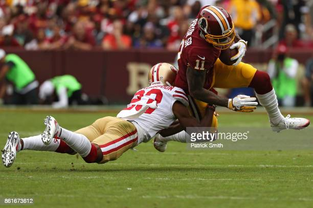 Wide receiver Terrelle Pryor of the Washington Redskins is tackled by Ahkello Witherspoon of the San Francisco 49ers during the first half at...