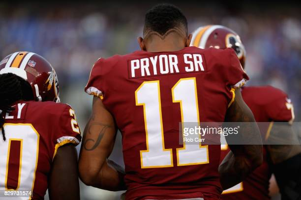 Wide receiver Terrelle Pryor of the Washington Redskins looks on in the huddle against the Baltimore Ravens during a preseason game at MT Bank...