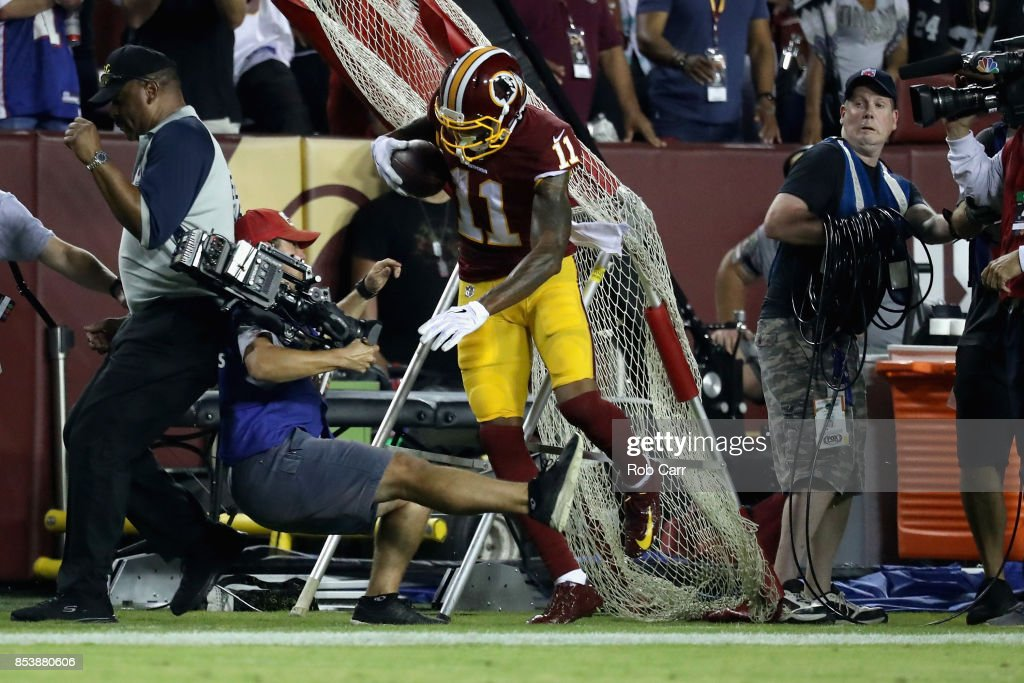 Wide receiver Terrelle Pryor #11 of the Washington Redskins runs into a videographer after catching a pass against the Oakland Raiders at FedExField on September 24, 2017 in Landover, Maryland.