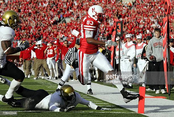 Wide receiver Terrence Nunn of the Nebraska Cornhuskers gets his toe in the endzone for a touchdown ahead of the diving reach of safety JJ...