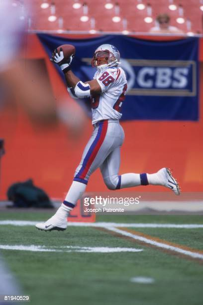 Wide receiver Terry Glenn of the New England Patriots catches a pass prior to playing against the Cleveland Browns at Cleveland Browns Stadium in...