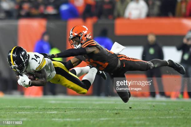 Wide receiver Tevin Jones of the Pittsburgh Steelers catches a pass against cornerback Denzel Ward of the Cleveland Browns in the second quarter of a...