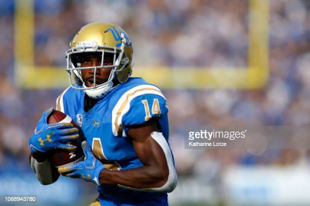 Wide receiver Theo Howard of the UCLA Bruins carries the ball down the field during the first half of a football game at Rose Bowl on November 17...