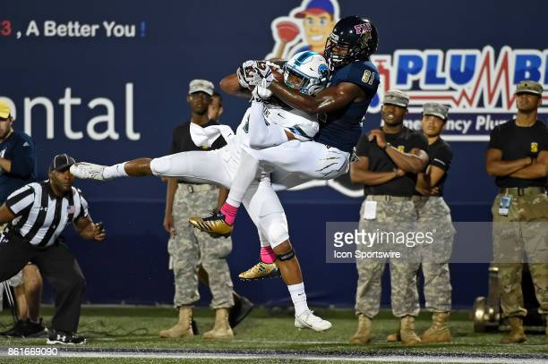 FIU wide receiver Thomas Owens attempts to pull in a reception in the first quarter but Tulane cornerback Parry Nickerson intercepted the pass in the...