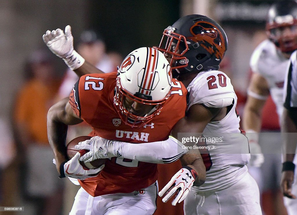 Wide receiver Tim Patrick #12 of the Utah Utes is tackled by Jhavari Ransom #20 of the Southern Utah Thunderbirds, after a first down catch in the third quarter Rice-Eccles Stadium on September 1, 2016 in Salt Lake City, Utah. The Utah Utes won 24-0.