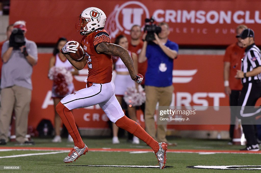 Wide receiver Tim Patrick #12 of the Utah Utes scores on a 57 yard pass reception, in the fourth quarter of their 24-0 win over the Southern Utah Thunderbirds, at Rice-Eccles Stadium on September 1, 2016 in Salt Lake City, Utah.