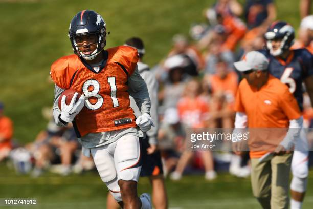 Wide receiver Tim Patrick runs out a catch from quarterback Chad Kelly during Denver Broncos training camp at the UCHealth Training Center August 7...