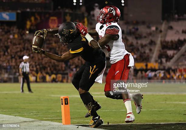 Wide receiver Tim White of the Arizona State Sun Devils catches a 12 yard touchdown reception ahead of defensive back Dominique Hatfield of the Utah...