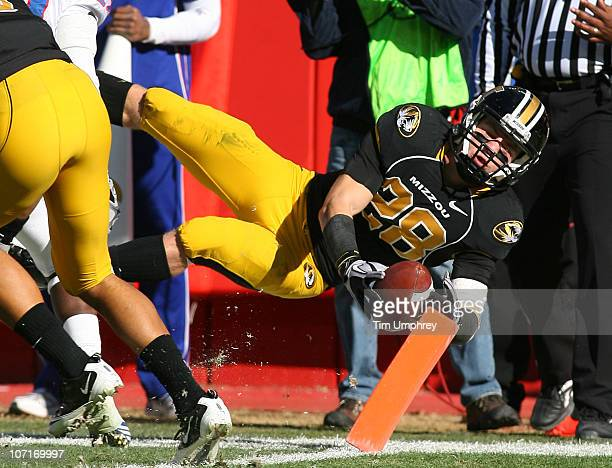 Wide receiver T.J. Moe of the Missouri Tigers dives for the end zone in a game against the Kansas Jayhawks on November 27, 2010 at Arrowhead Stadium...