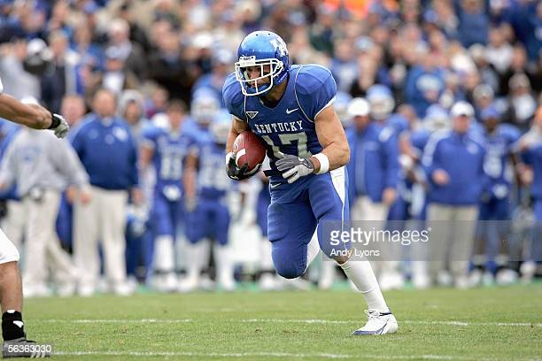 Wide receiver Tommy Cook of the Kentucky Wildcats carries the ball against the Tennessee Volunteers at Commonwealth Stadium on November 26 2005 in...