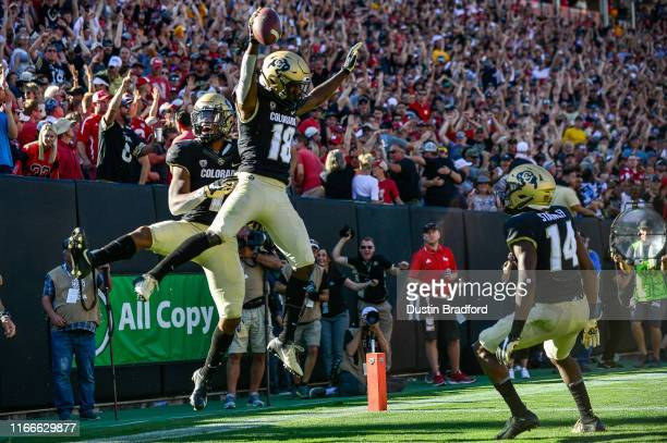 Wide receiver Tony Brown of the Colorado Buffaloes celebrates a fourth quarter touchdown reception with wide receiver Wan'Dale Robinson during a game...