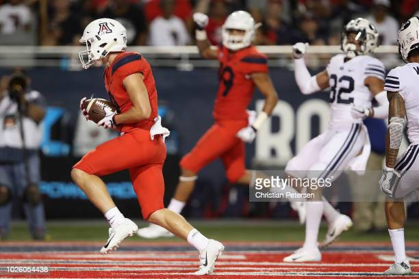 Wide receiver Tony Ellison of the Arizona Wildcats catches a 15 yard touchdown reception against the Brigham Young Cougars during the first half of...